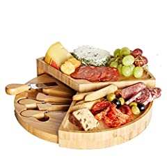 100% BAMBOO WOOD – on-trend, premium cheese board set with 3 specialist cheese tools. INNOVATIVE DESIGN – opens up to reveal three tiers with concealed knife tray CHEESE TOOLS – comes complete with cheddar knife, hard cheese knife and cheese fork – a...