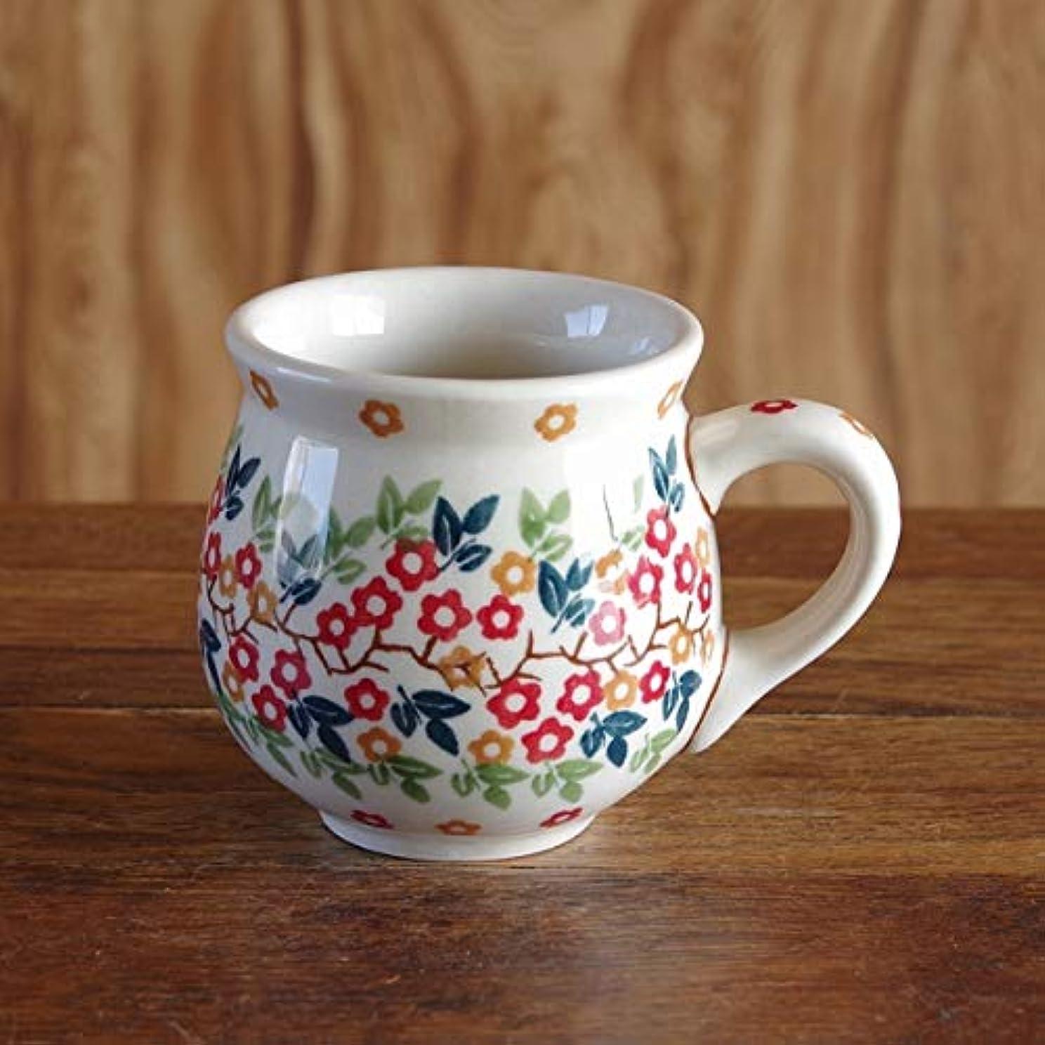 憲法好奇心政治的ポーランド食器 ポーリッシュポタリー マグカップ 200ml ボレスワヴィエツ陶器 Boleslawiec ポップ オレンジ色の小花柄 K67-KK02