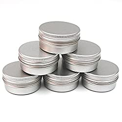 Image of several lightweight metal containers, which are ideal for portioning out travel-sized zero waste toiletries for your travel toiletry bag