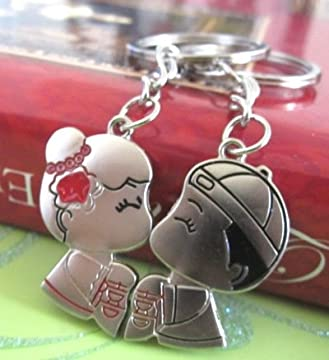 Romantic keychain with cute cartoon chinese / asian / japanese couple kissing on the lips