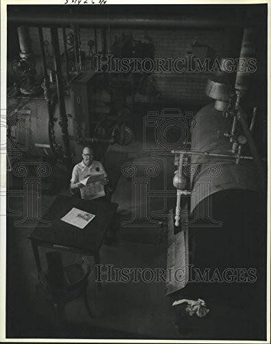 Vintage Photos 1990 Press Photo Harold Brett Reads Paper Next to Very Large boilers at N.O.A.C.