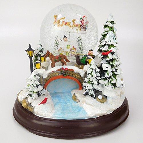 CHRISTMAS CONCEPTS LTD 23cm Musical de Navidad Decoración Resina con la Navidad Bola de Nieve + Moving Reno Trineo con Las Luces LED con Pilas