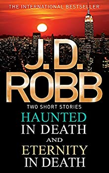 Paperback Haunted In Death Eternity In Death Book