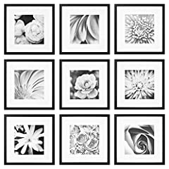 Nine square photo frames in black wood with removable classic white mats Frame sizes included in kit: (9) 12x12 frames with mat for 8x8 image display Square frames can be hung in grid-like arrangement with secure hanging hardware included with each f...