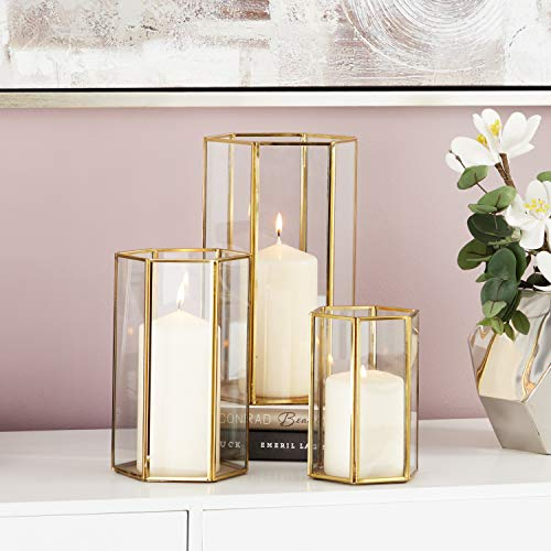 "CosmoLiving by Cosmopolitan 57378 Large Modern Metallic Gold Metal & Glass Candle Holders with Hexagon Silhouettes| Set of 3: 6"" x 10"", 5"" x 8"", 4"" x 6"""