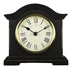 Aged effect wood composite case Antique brass effect bezel with glass lens Metal spade hands Clear Roman dial Dimensions: 180 x 190 x 60mm. Requires 1 x AA battery (not included)