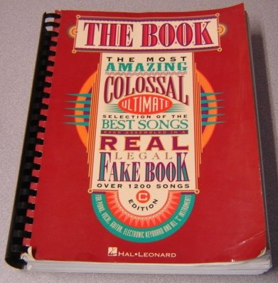 THE BOOK: THE MOST AMAZING COLOSSAL ULTIMATE SELECTION OF THE BEST SONGS EVER ASSEMBLED IN A REAL FAKE BOOK OVER 1200 SONGS FOR PIANO, VOCAL, GUITAR, ELECTRONIC KEYBOARD AND ALL 'C' INSTRUMENTS