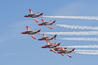 Spanish aerobatic team Patrulla Aguila performing at an airshow in Morocco Poster Print by Daniele FaccioliStocktrek Image...