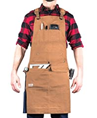 WOODWORKER EDITION: Our flagship work apron updated for the woodworking enthusiast or pro. Built with padded straps, saw dust flaps over pockets, dual hammers loops, a quick release buckle fastener, and additional pencil pockets for all-day comfort. ...