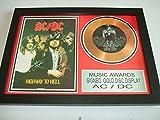 Disco dorado firmado AC/DC