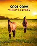 2021-2022 Weekly Planner: Two Year Calendar Agenda Organizer: 24 Months Weekly Planner with Vision Boards Notes To-Do's. Beautiful Wild Horses in the Sunset.