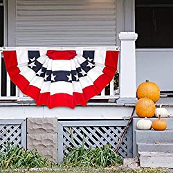An American pleated fan flag hung on a house's porch railings.