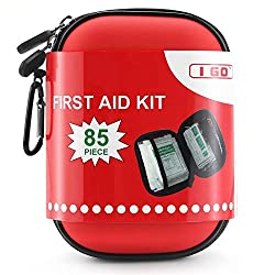 A small, compact red first aid kit.