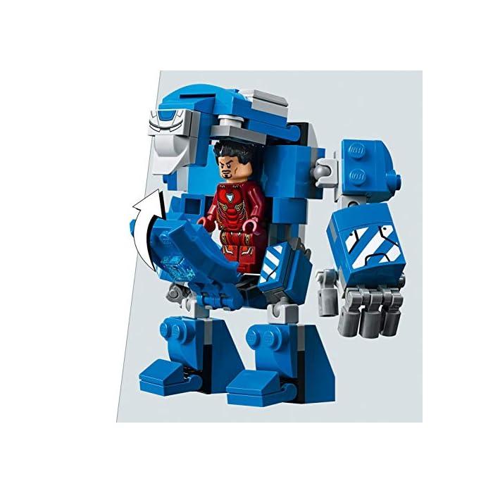 51WVYGc2ZSL Incluye 6 minifiguras del universo Marvel: Iron Man MK 1, Iron Man MK 5, Iron Man MK 41, Iron Man MK 50 y dos Outriders. Este juguete de superhéroes para construir contiene un laboratorio de Iron Man con módulos desmontables que se pueden combinar y apilar de muchas maneras diferentes para crear experiencias de juego alternativas. El laboratorio de Iron Man incluye una plataforma giratoria con 2 brazos robóticos articulados; una mesa con una pantalla de color azul translúcido, silla para una minifigura y taza; un módulo de cocina con licuadora para preparar batidos para construir y taza; un módulo de armería con un cañón, una potente mochila propulsora y un elemento que representa el rayo de energía para las minifiguras; un módulo de almacenamiento de herramientas con llave inglesa; módulos para guardar las armaduras de Iron Man; una antena de radar; barreras de seguridad; y un extintor y 2 elementos que representan las llamas.