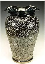 Large black puzzle vessel