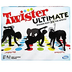 Twister game with shadows of people standing on colorful spots
