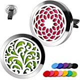 two stainless steel, round vent clips one with a tree design, the other a mosaic design