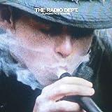 Songtexte von The Radio Dept. - Clinging to a Scheme