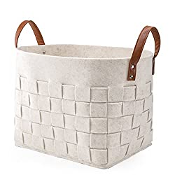 white woven basket with leather handles