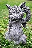 Figura decorativa de dragón de jardín desconocido que se araña en la oreja