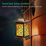 TomCare Solar Lights Metal Solar Lantern Flickering Flame Outdoor Hanging Lanterns Lighting Heavy Duty Waterproof Solar Powered LED Flame Umbrella Lights for Garden Patio Pathway Deck Yard, 2 Pack Mounted to side of building