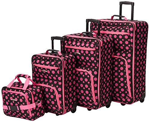 A black and pink dot luggage set is made from a tough polyester material, which makes the whole set lighter. But they're still more than capable.