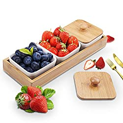 Serving tray with 3 compartments with blueberries, strawberries and other fruit for mimosa bar garnishes