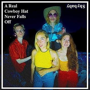 A Real Cowboy Hat Never Falls Off