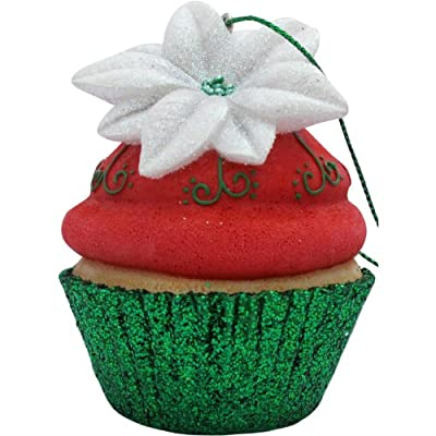 Cupcake ornament in a green liner decorated with red frosting and a white poinsettia