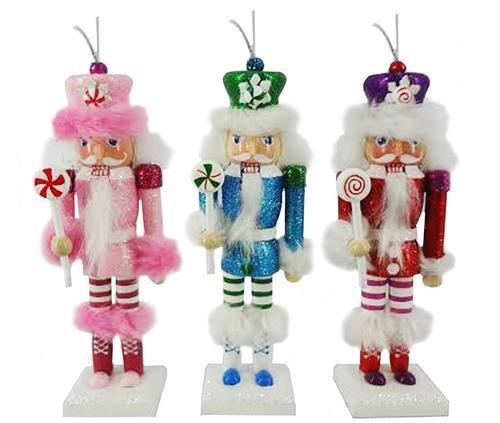 크리스마스 호두까기 인형 3인조 브라이트 핑크 블루 레드 세트에서 캔디와 함께 휘밍크를 하는 군인들