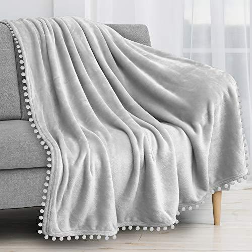 PAVILIA Pom Pom Blanket Throw, Light Gray Silver | Soft Fleece Pompom Fringe Blanket for Couch Bed Sofa | Decorative Cozy Plush Warm Flannel Velvet Tassel Throw Blanket, 50x60