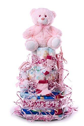 Flores AVRIL ofrece: tarta de pañales para bebé niña. Un regalo original para el bebé recién nacido, incluyendo 30 pañales de la marca DODOT más peluche más calcetín más toallas DODOT más toalla facial