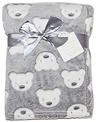This is a gorgeous baby soft fleece blanket. With a super soft fluffy feel to the blanket. Cute white teddy pattern throughout complimented against the grey fleece material. Ideal for general use or lovely as a gift! Size: 75 x 100cm