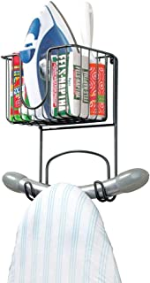 mDesign Wall Mount Metal Ironing Board Holder with Small Storage Basket - Holds Iron, Board, Spray Bottles, Starch, Fabric Refresher for Laundry Rooms - Black
