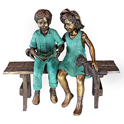 girl and boy reading garden statue