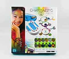 Charmazing Deluxe Charm Collector Set includes: * 2 Charm Collections - Beach Fun & Wild BFF; * 22 Charms total; * Exclusive Phone Jewelry & Phone Skins; Charmazing is the perfect Design-It-Yourself jewelry craft line, for young designers with a pass...
