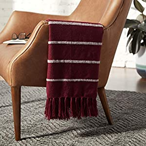 "Imported This acrylic throw blanket offers an effortless blend of comfort and chic. Dark red and ivory stripes of varying thickness run down the length of it, and the fringe on both ends add an extra bit of visual intrigue. 80""L x 60""W Striped, textu..."