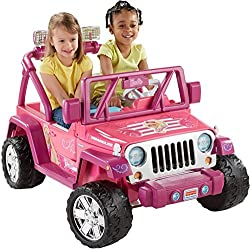 Two girls driving Pink truck