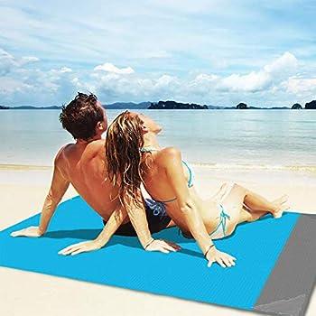 OUHO Couverture de plage 145 x 190 cm Tapis de pique-nique, anti-sable, portable, imperméable, avec filet et 4 piquets fixed pour pique-nique, plage, voyage, randonnée.