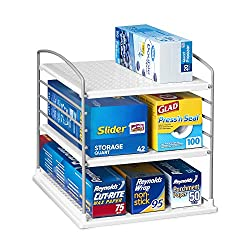 3 level white plastic and metal organizing shelf with boxes of plastic bags and wraps