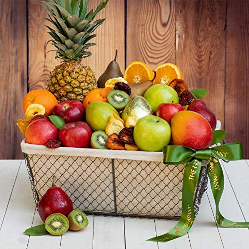 The Fruit Company- Orchard Celebration Fruit Basket-18 Pieces Premium Fresh Pears, Apples, Oranges, Kiwi, Pineapple, and Mango with a Dried Fruit Medley in a Reusable Wire and Cloth Lined Basket