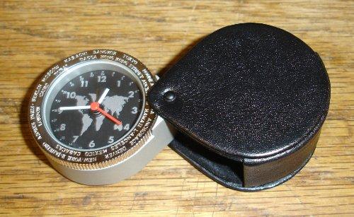 Mini travel alarm clock with black swivel-back leather case