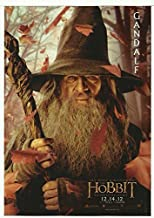 The Hobbit: An Unexpected Journey Ian McKellan as Gandalf Staff & Hat with logo 8 x 10 Ph