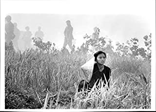 Vintage photo of Hiep Thi Le in farm in
