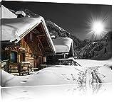 wunderschöne verschneite Alpenhütten schwarz/weiß