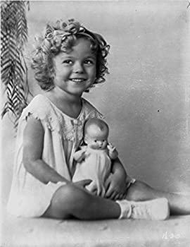 Shirley Temple wearing a House Dress and Holding a Doll in a Classic Portrait Photo Print  8 x 10
