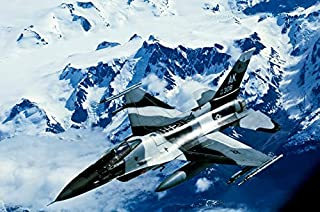 An F-16C Falcon from the 18th Aggressor Squadron flies over an Alaskan mountain range Poster Print by Stocktrek Images (17...