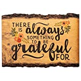 "Features sentiment that reads ""There is always something to be grateful for""; Exposed bark design with floral artwork paired with sentiment of hope and inspiration Decorative sign is constructed of MDF (Medium Density Fiberboard); Rustic home accent ..."