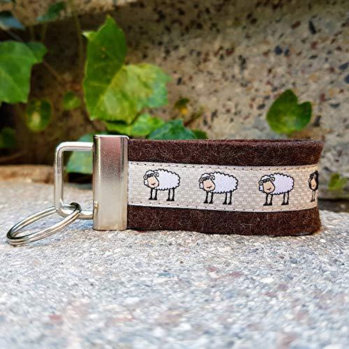 Schlüsselanhänger Taschenanhänger Wollfilz dunkelbraun Webband Schafe weiß schwarz beige Geschenk