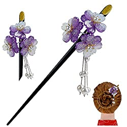 Image of a hair stick decorated with purple flowers and little tassles